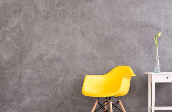 yellow-chair-in-grey-wall-interior-PZED8LY